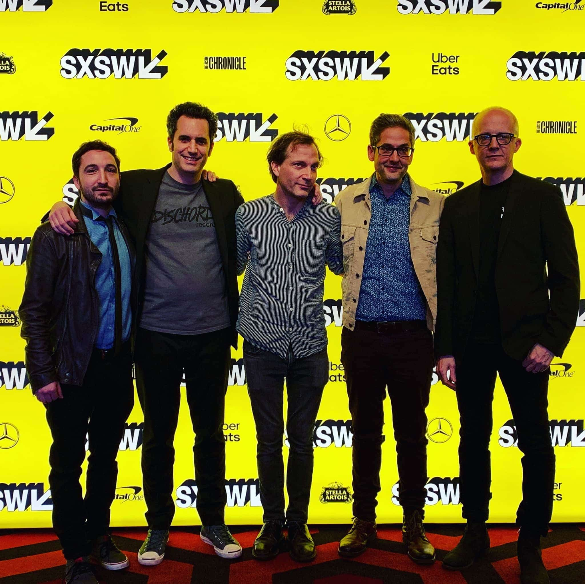 L – R SX photo: Ian Jacobs (Producer/Editor), Eric Mahoney (Director/Producer), John Schmersal (Brainiac, Guitar), Tyler Trent (Brainiac, Drums), Juan Monasterio (Brainiac, Bass)